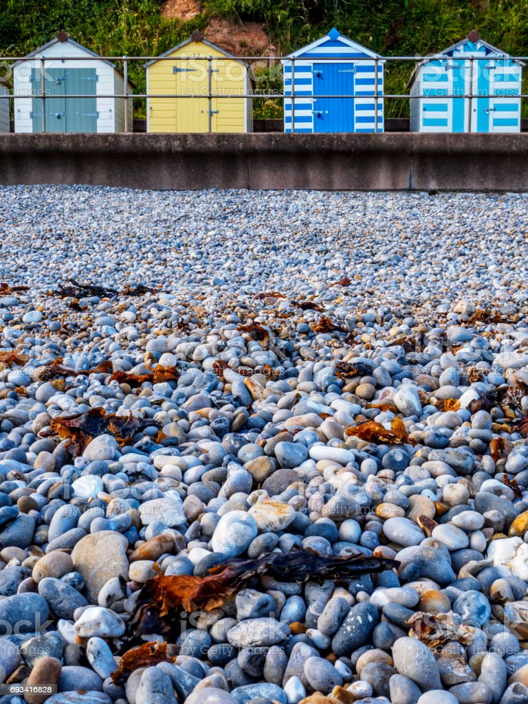 Budleigh Beach Huts and rocks stock photo