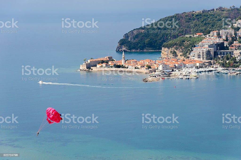 Budva old town parasailing stock photo