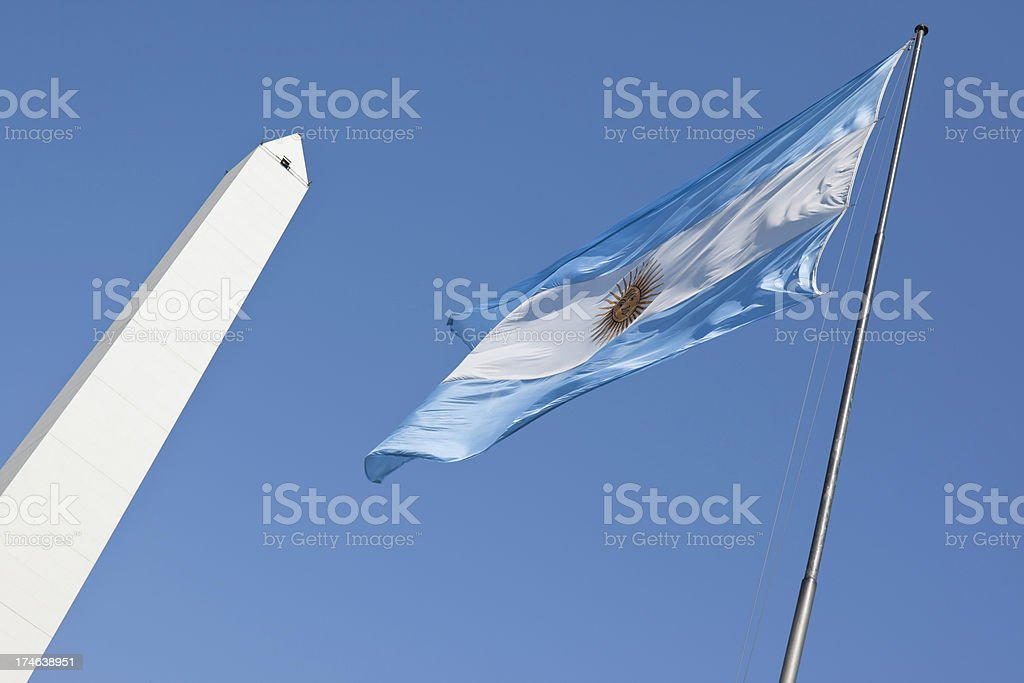 Buenos Aires obelisco with argentine flag stock photo