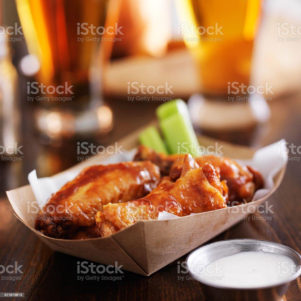 buffalo chicken wings in basket stock photo