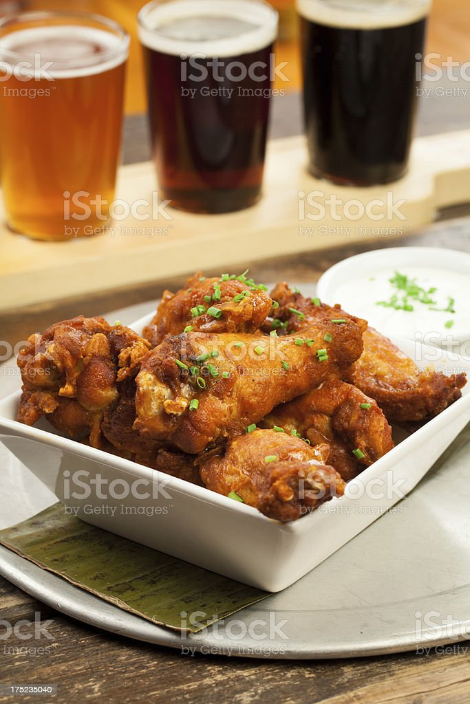 Buffalo chicken wings with beer sampler royalty-free stock photo