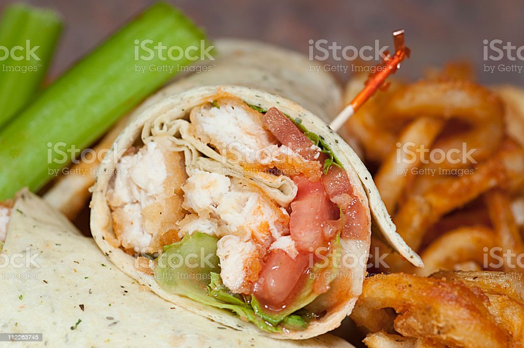 buffalo chicken wrap and fries stock photo