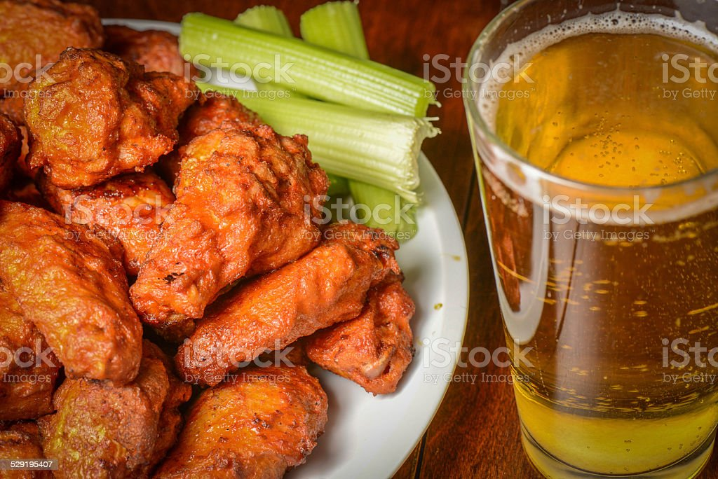 Buffalo Wings with Celery Sticks and Beer stock photo