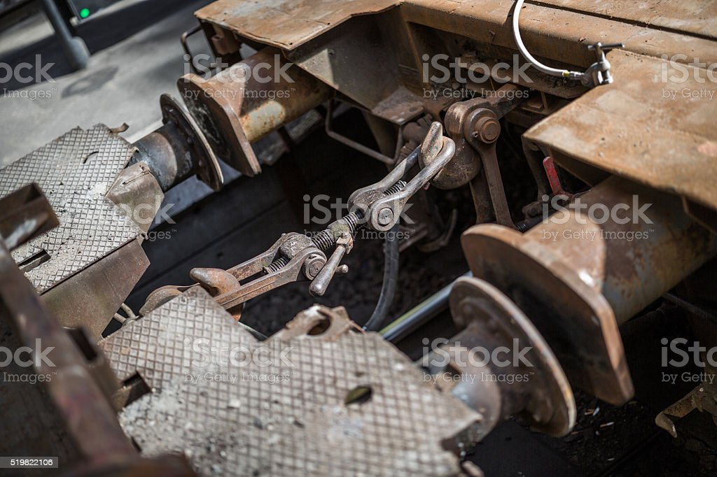Buffer-and-chain couplers on train wagons stock photo