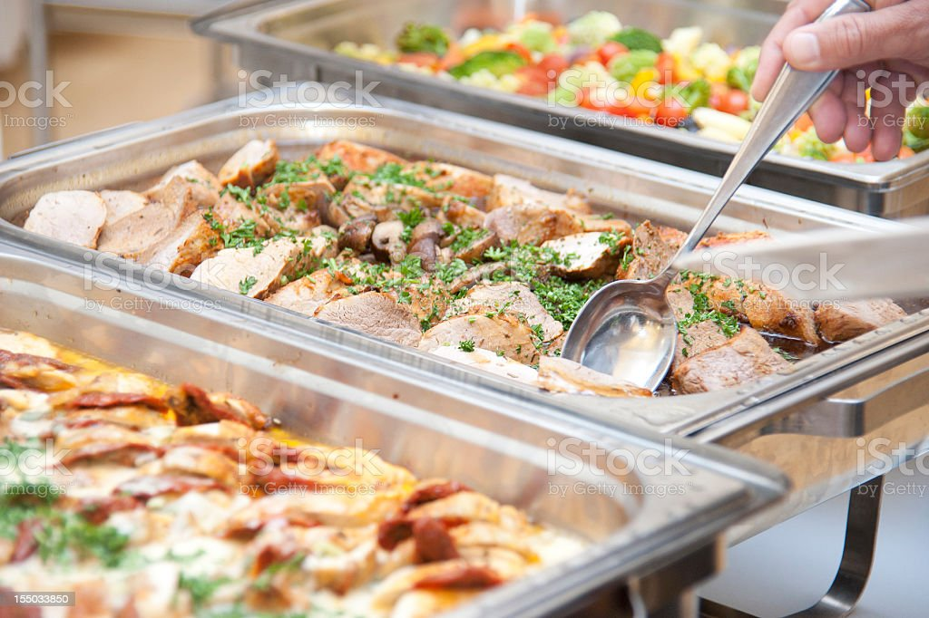 buffet catering diagonal view with spoon and meat stock photo