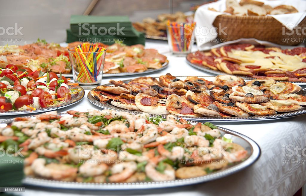 buffet catering food an plates side view royalty-free stock photo