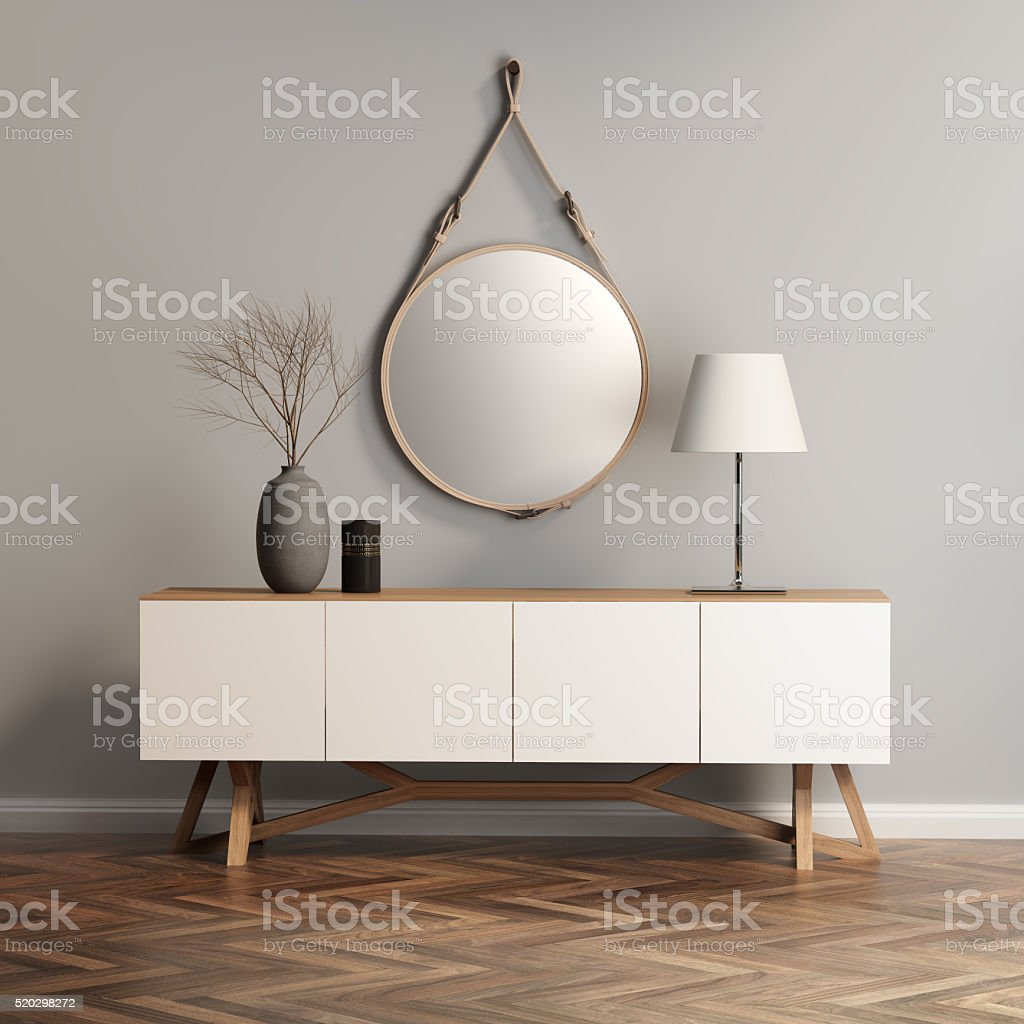 Buffet, console table on grey wall stock photo