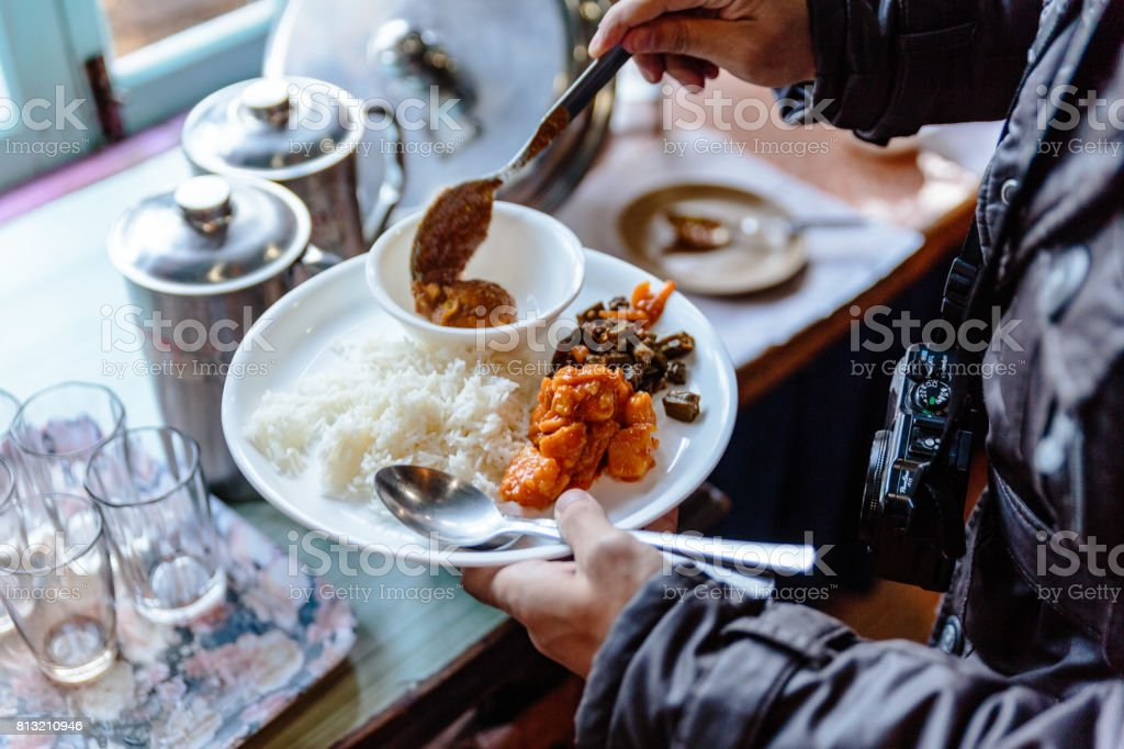 Buffet rice with sweet potato curry and egg curry with prickled chilli  is a lunch of hotel in winter at Lachen. North Sikkim, India. stock photo