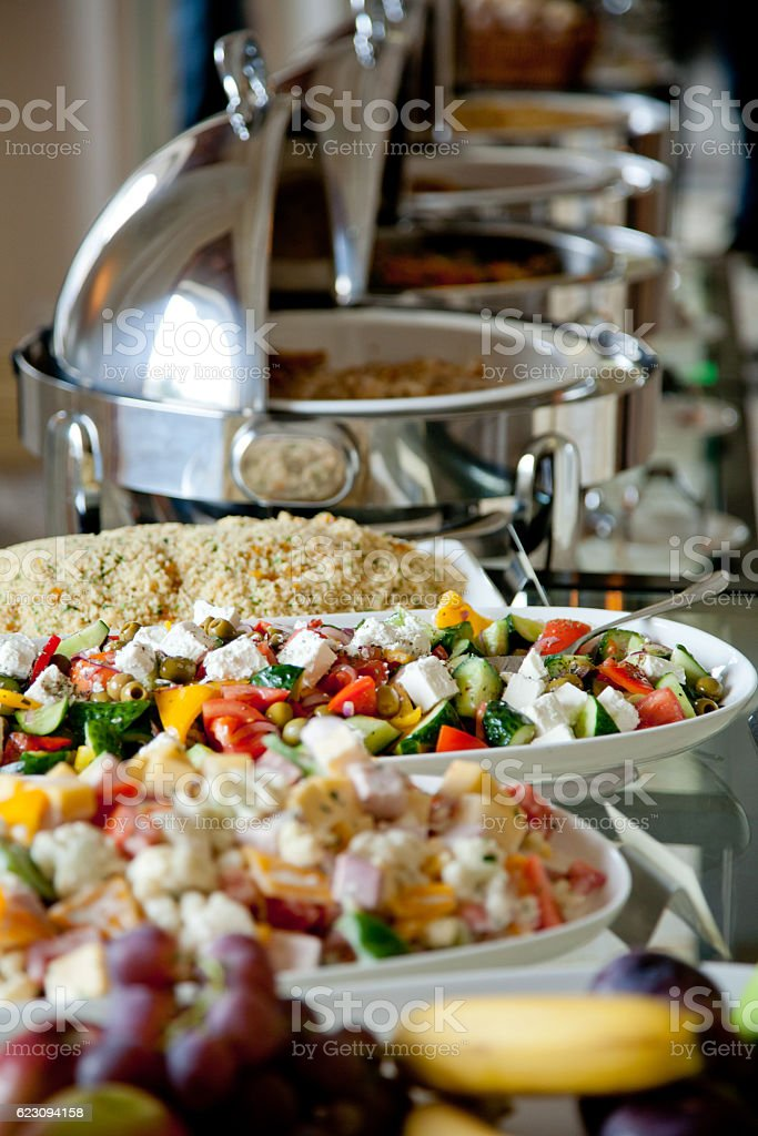 buffet table with salads and fruits stock photo