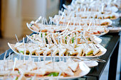 buffet table with small sandwiches