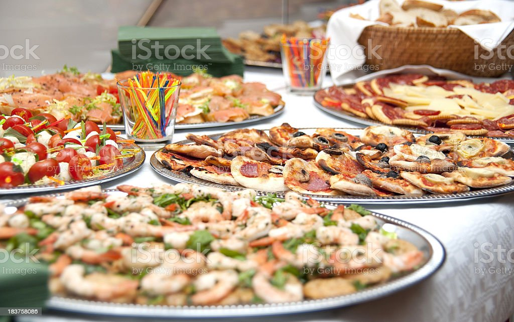 buffet unopened and full of delicious food stock photo