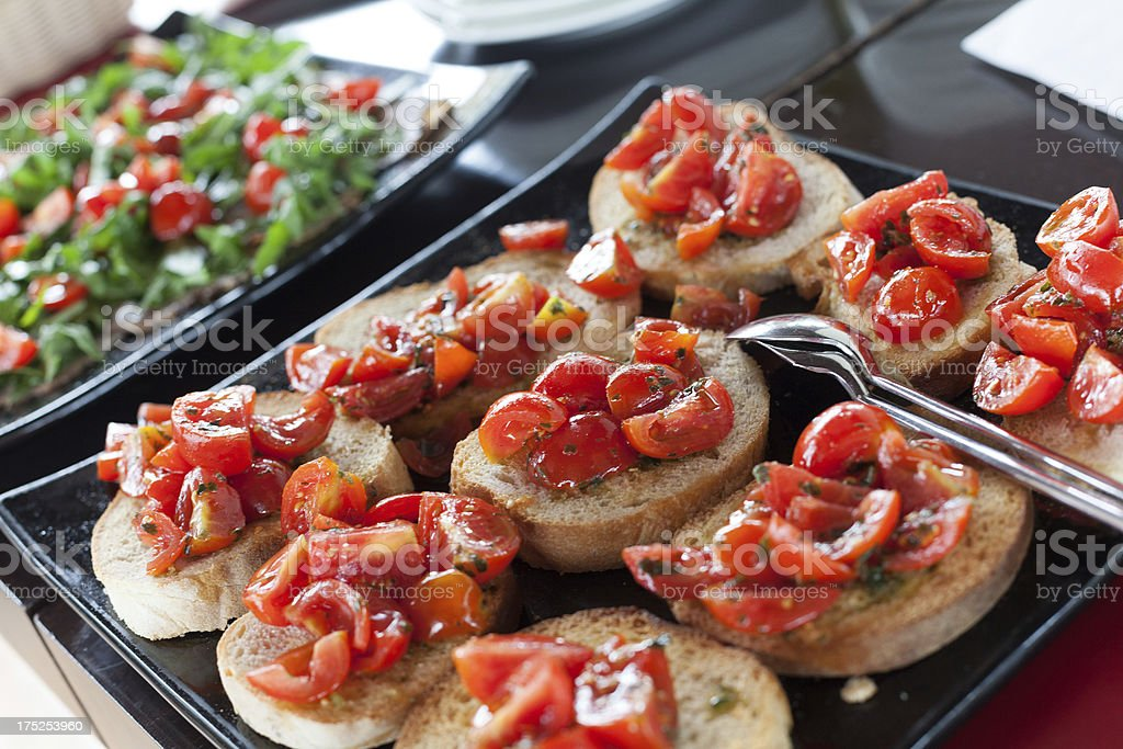 Buffet with Fresh Bruschetta, Tomato and Salad royalty-free stock photo