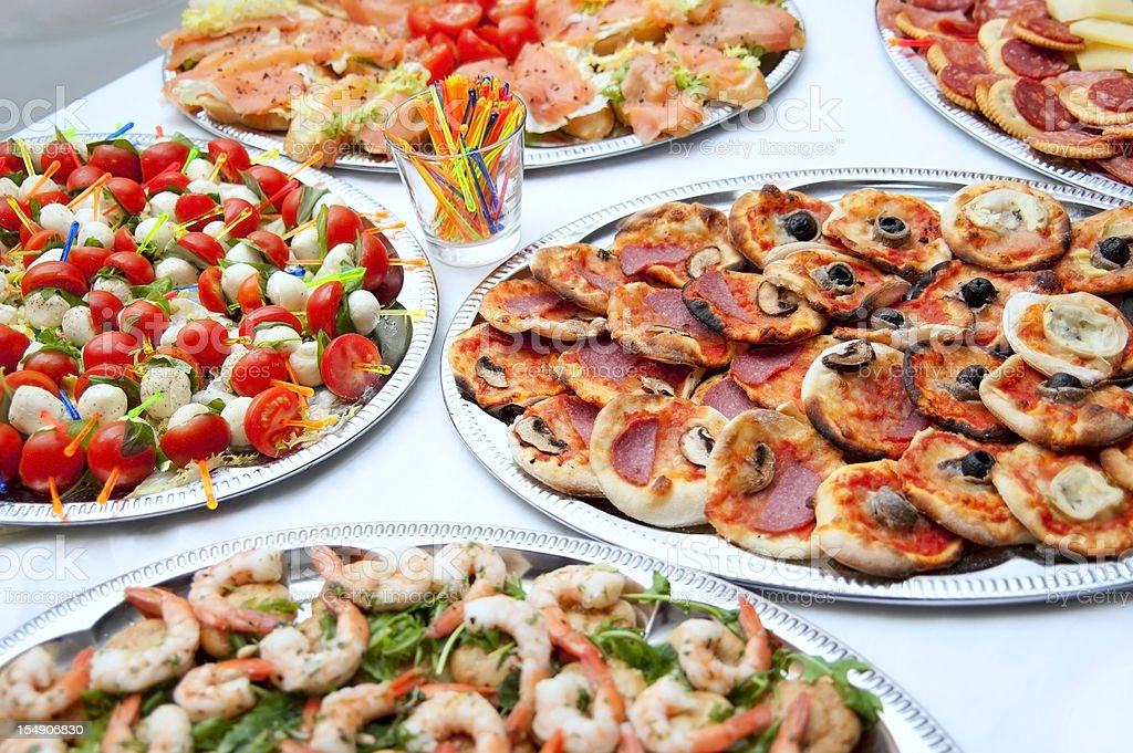 buffet with luscious tomatoes, pizza, salmone and shrimps royalty-free stock photo
