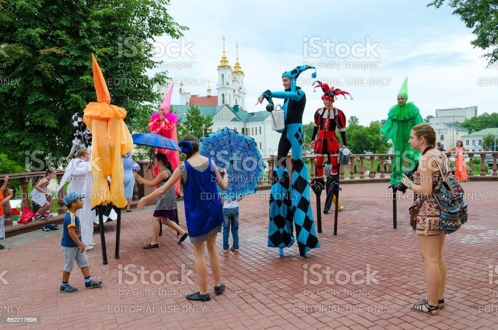 Buffoons on stilts near puppet theater, Vitebsk, Belarus stock photo