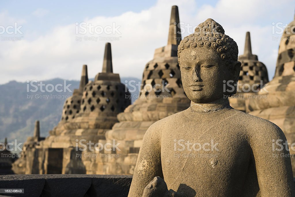 Buggha statue and stupas in Borobudur temple, Indonesia royalty-free stock photo