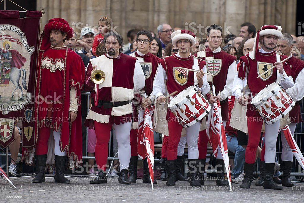 Bugler and drummer, in medieval reenactment costumes royalty-free stock photo