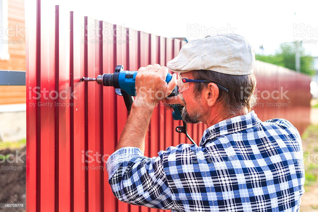 build a metal fence stock photo