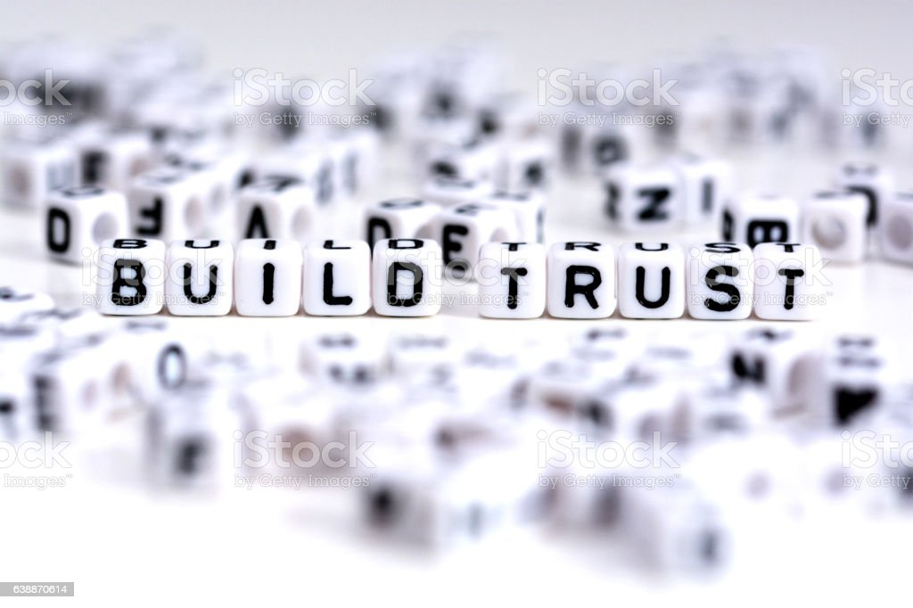 Build trust process concept with tiled letters on white background stock photo