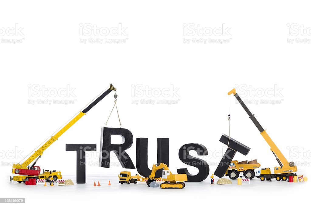 Build up trust: Machines building trust-word. stock photo