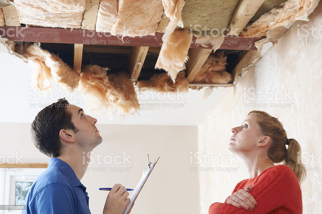 Builder And Client Inspecting Roof Damage royalty-free stock photo