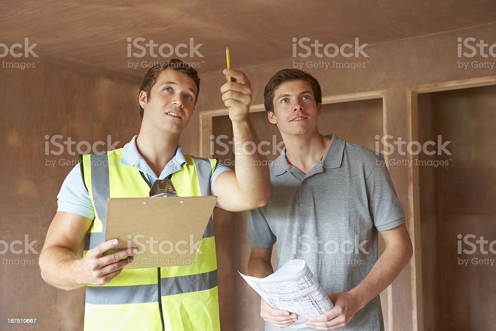 Builder And Inspector Looking At New Property stock photo