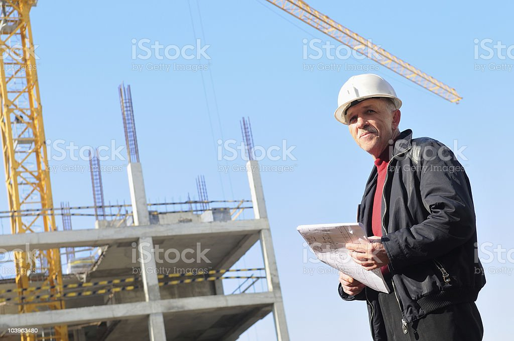 builder at construction site royalty-free stock photo