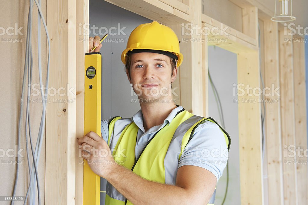 Builder Checking Work With Spirit Level royalty-free stock photo