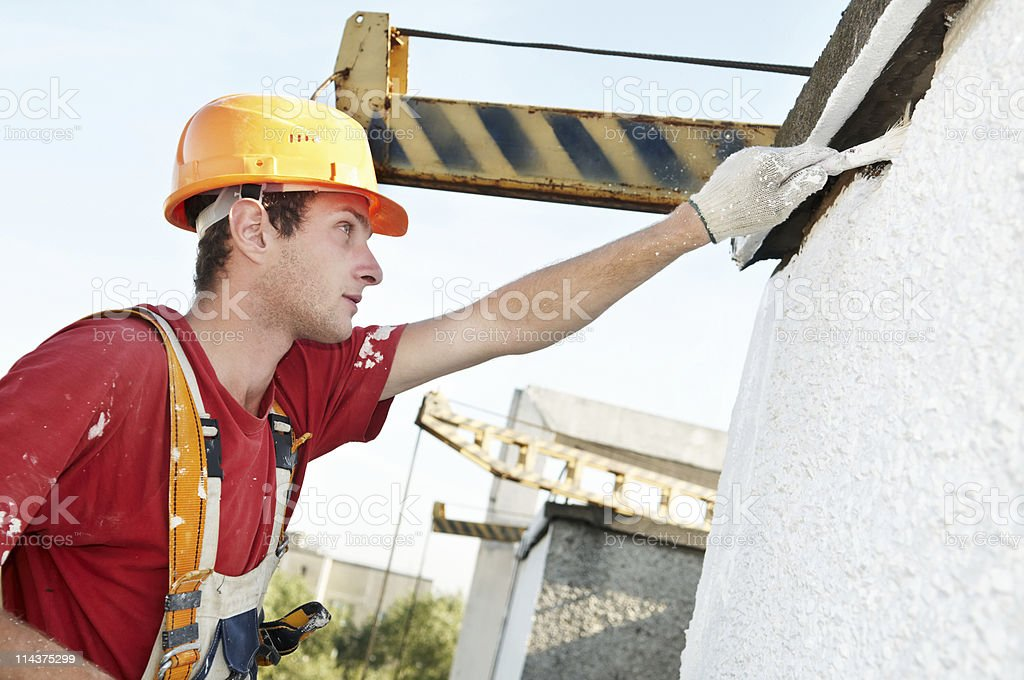 builder facade painter at work royalty-free stock photo