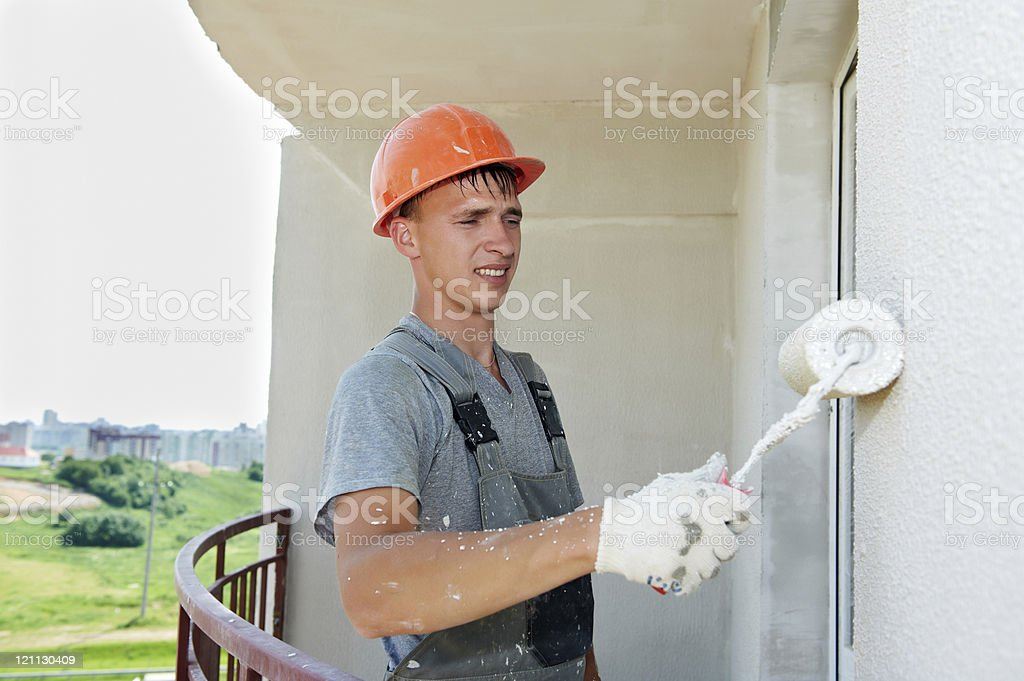 builder facade plasterer worker royalty-free stock photo