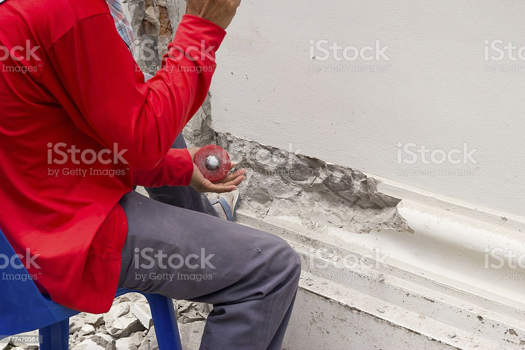 builder hitting  wall with  sledge hammer royalty-free stock photo