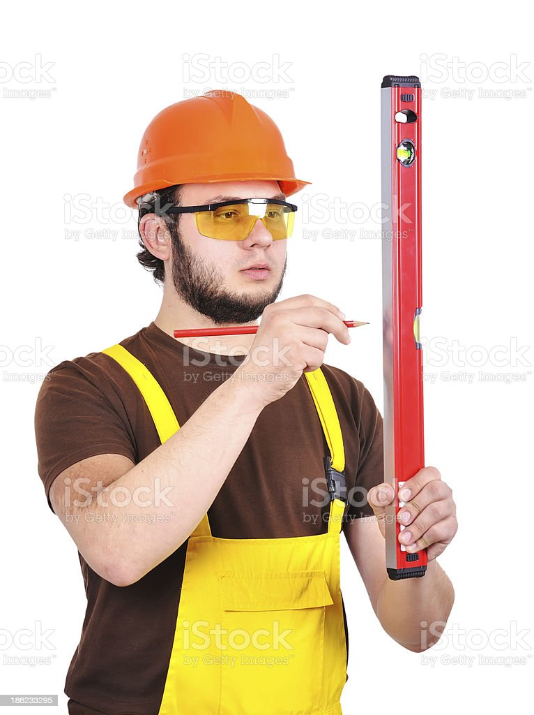 builder holding wasserwaage and pencil royalty-free stock photo