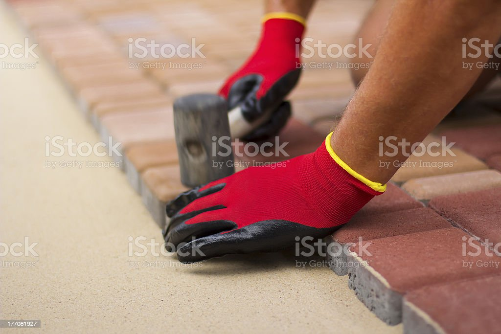 Builder lays paving stones. royalty-free stock photo