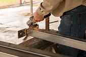 Builder making steel stumps