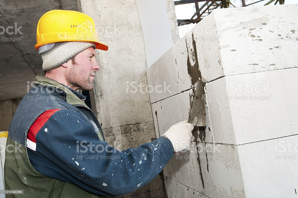 builder mason at bricklaying work royalty-free stock photo