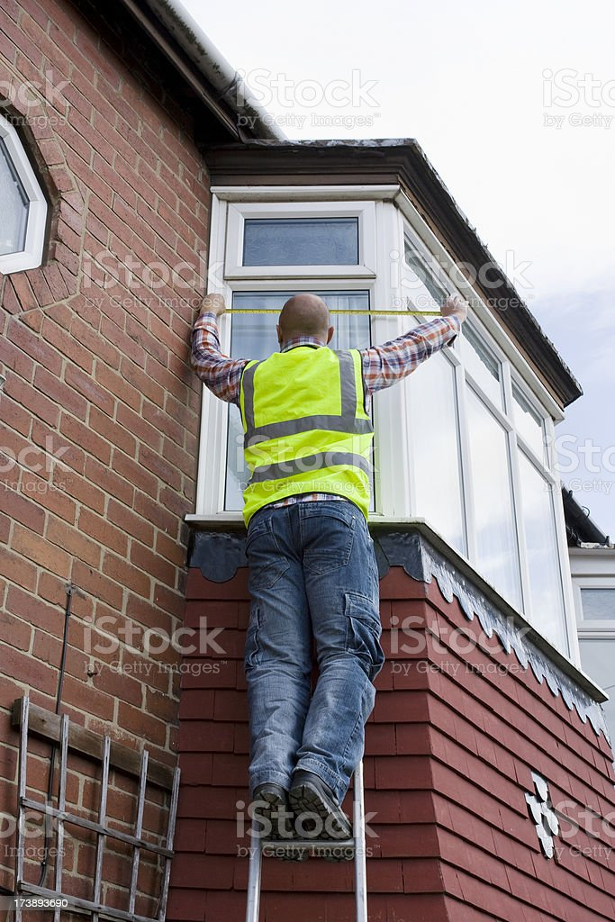 Builder Measuring royalty-free stock photo