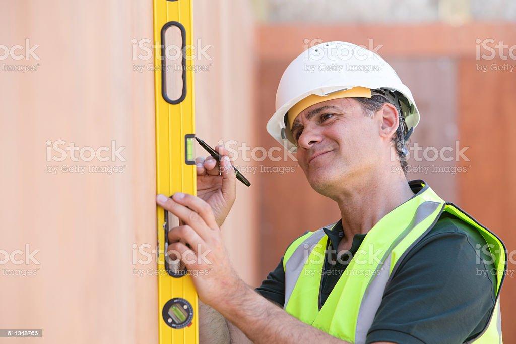 Builder Measuring With Spirit Level stock photo