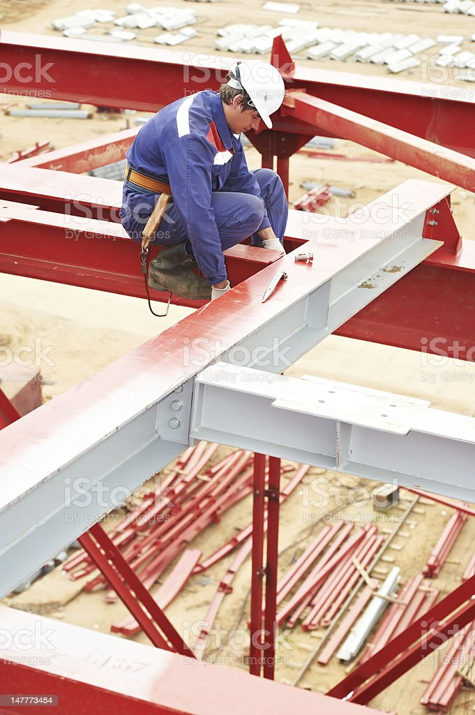 builder millwright worker at construction site stock photo