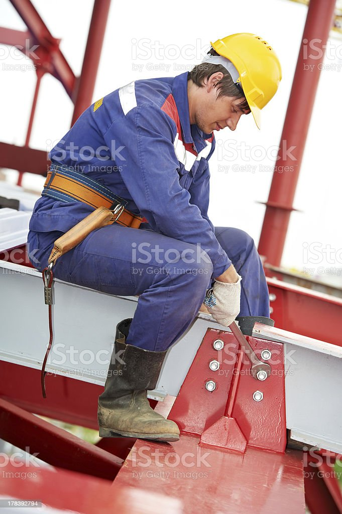 builder millwright worker at construction site royalty-free stock photo