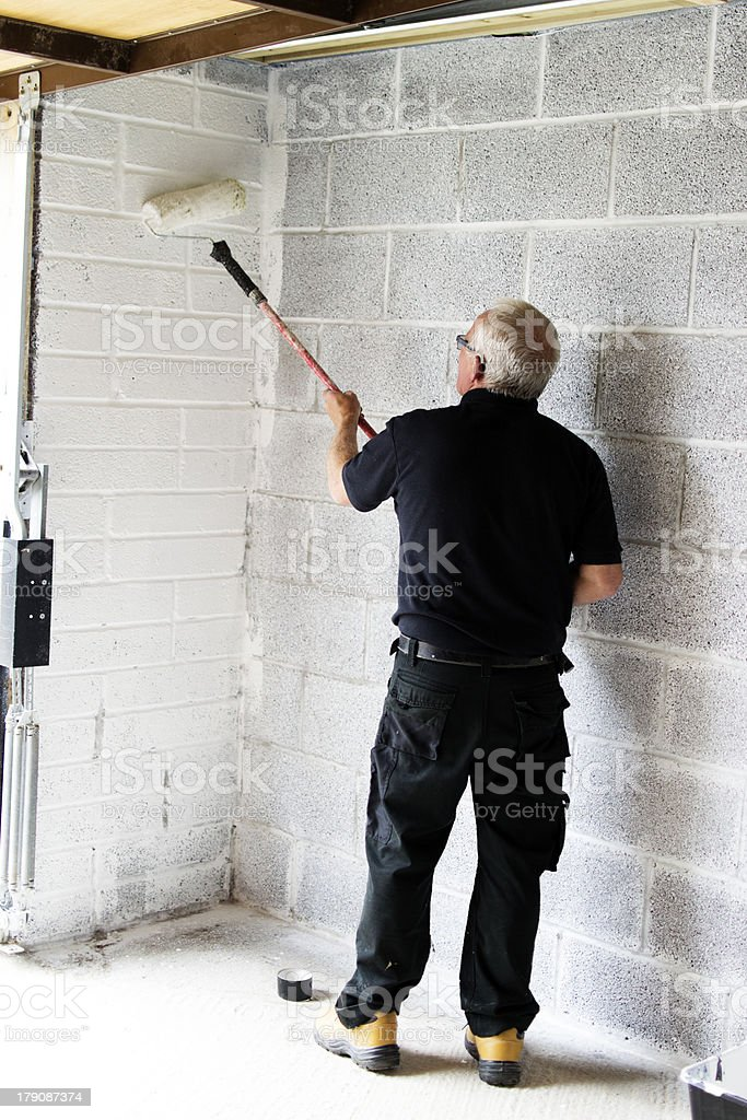 Builder painting stock photo