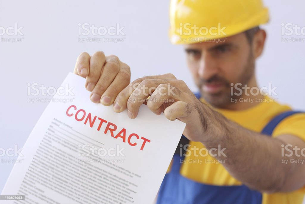 Builder ripping up a contract stock photo