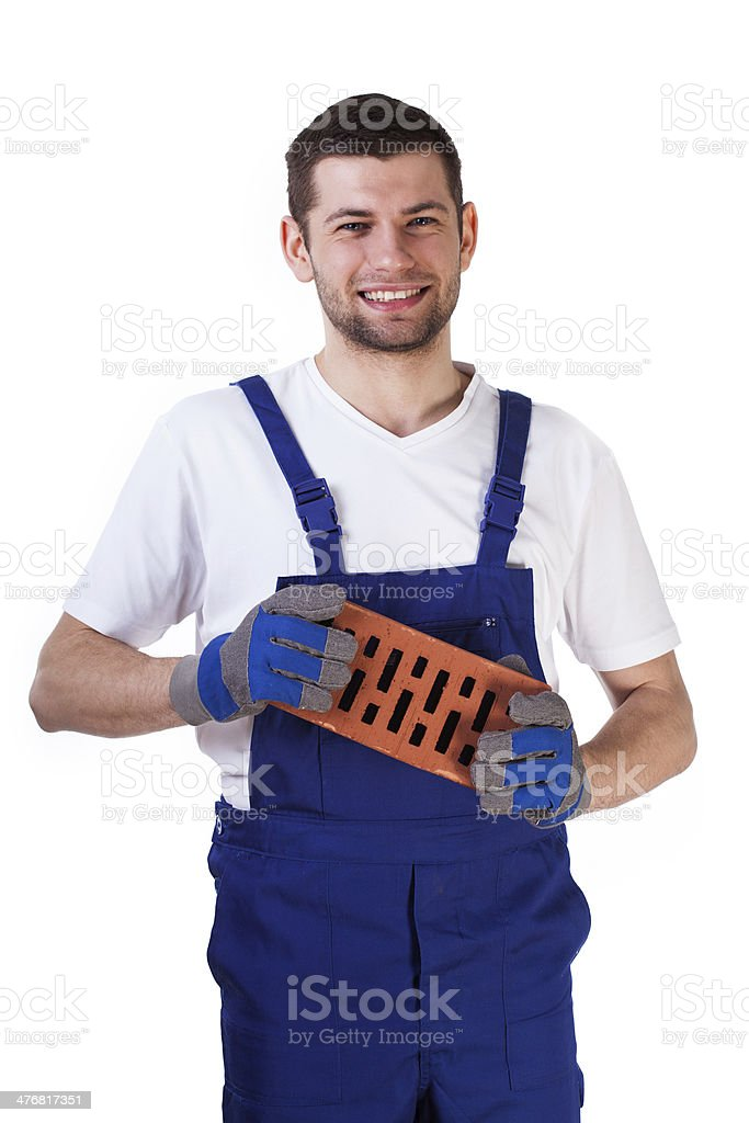 Builder standing with red brick royalty-free stock photo