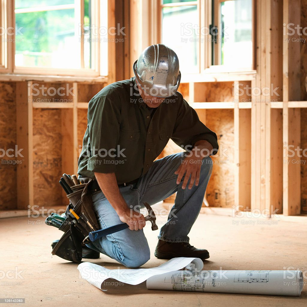 Builder with Blueprints royalty-free stock photo