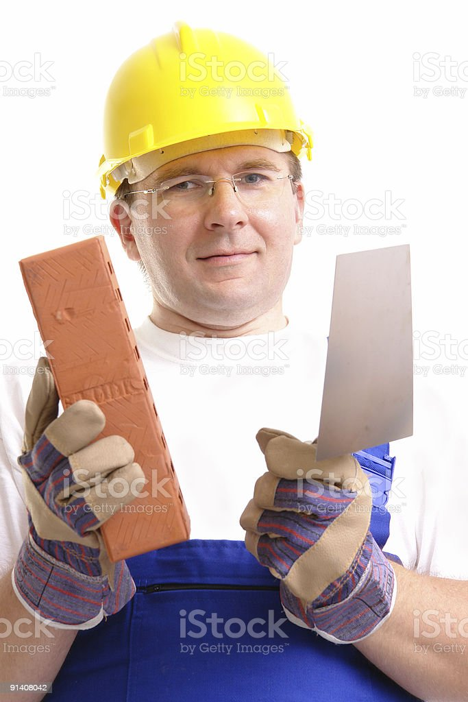 Builder with brick and trowel royalty-free stock photo