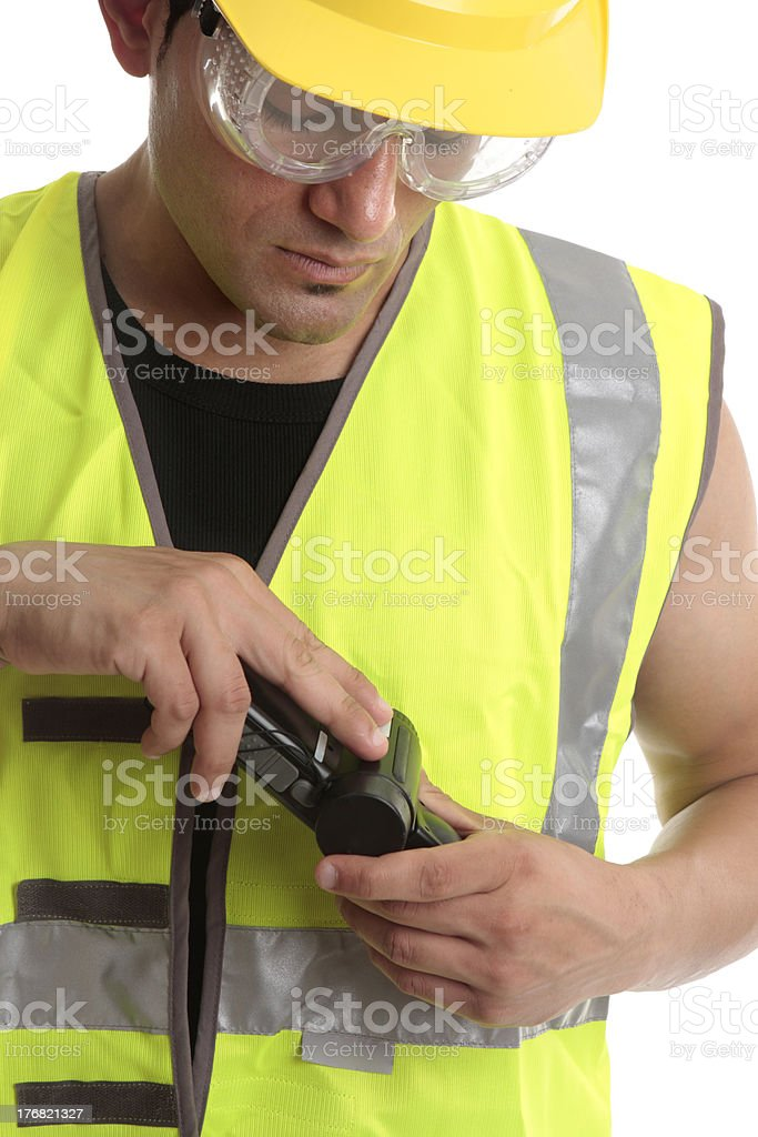 Builder with measuring device royalty-free stock photo