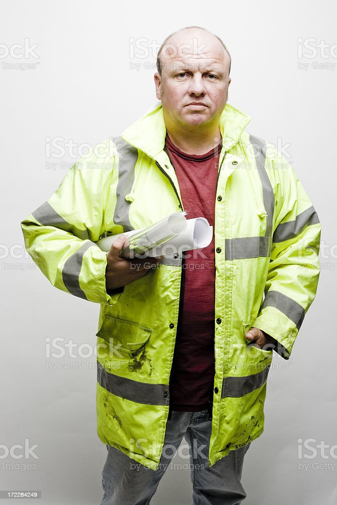 Builder with plans royalty-free stock photo
