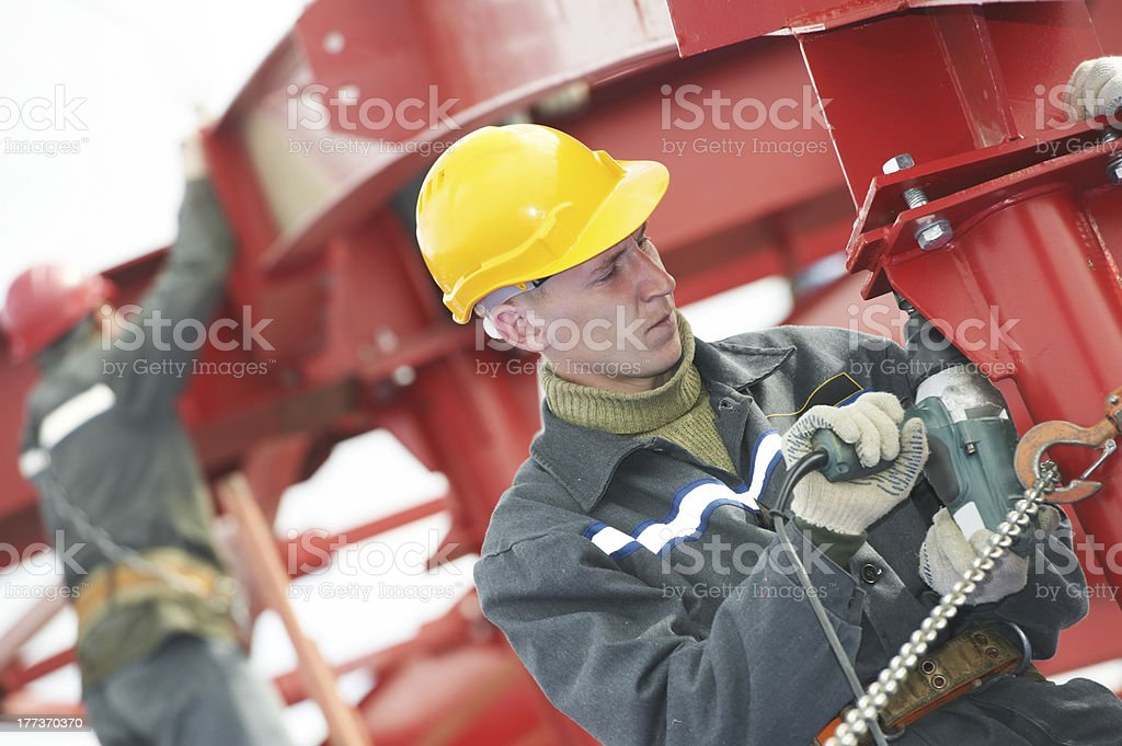builder worker assembling metal construction royalty-free stock photo