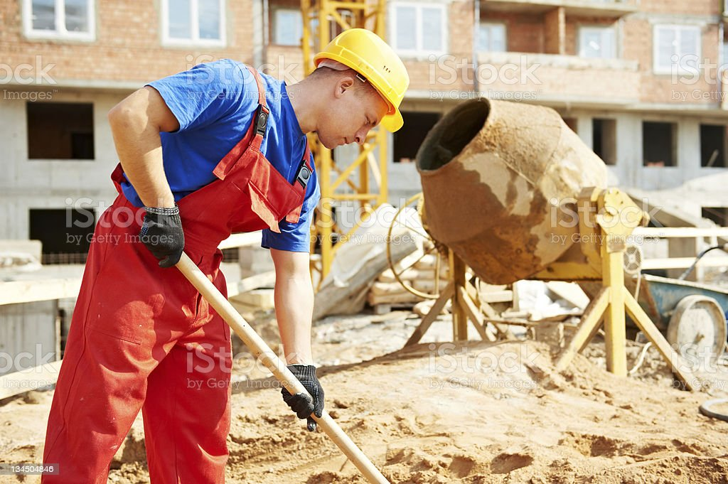 builder worker at construction site with shovel stock photo