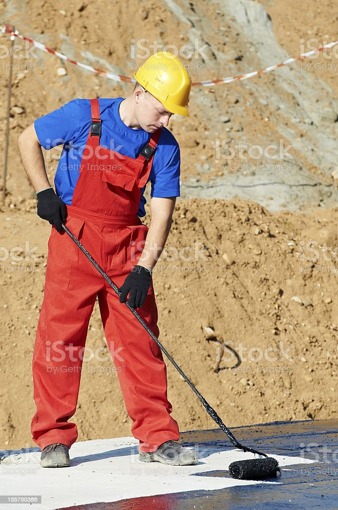 builder worker at roof insulation work royalty-free stock photo