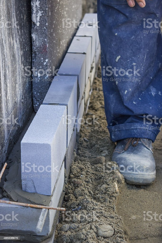 builder worker installing insulation layer 2 royalty-free stock photo