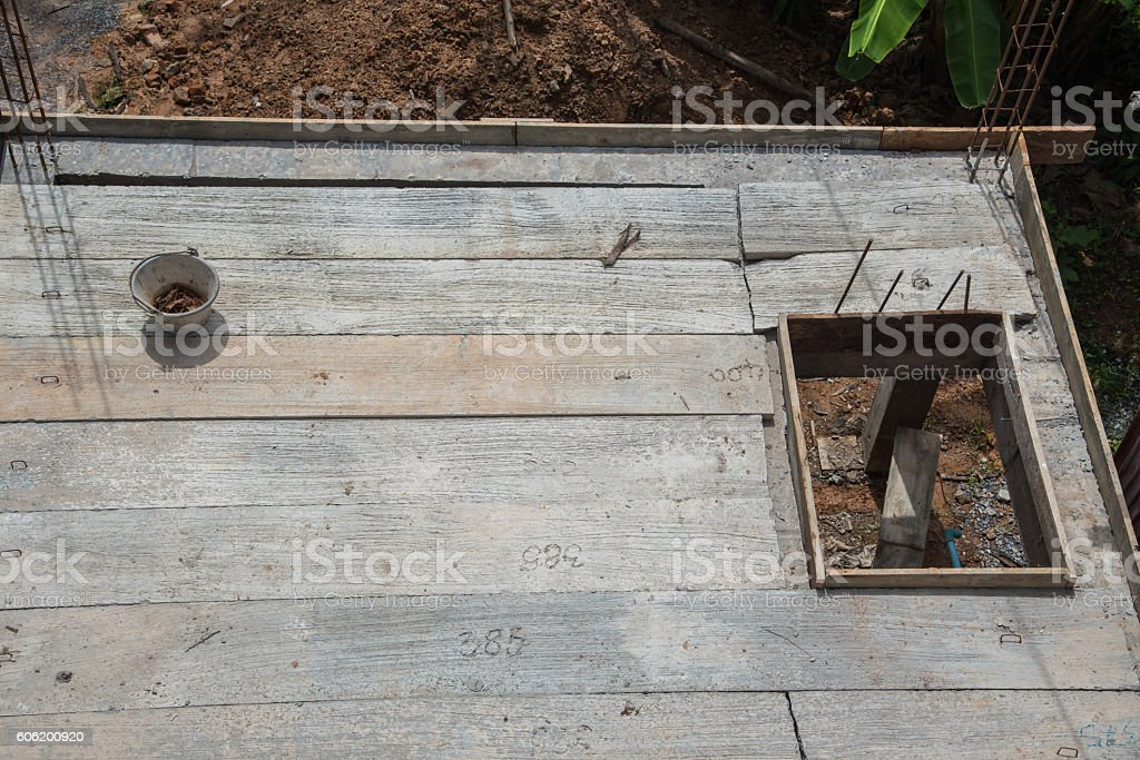 Builder worker man installing cement floor stock photo